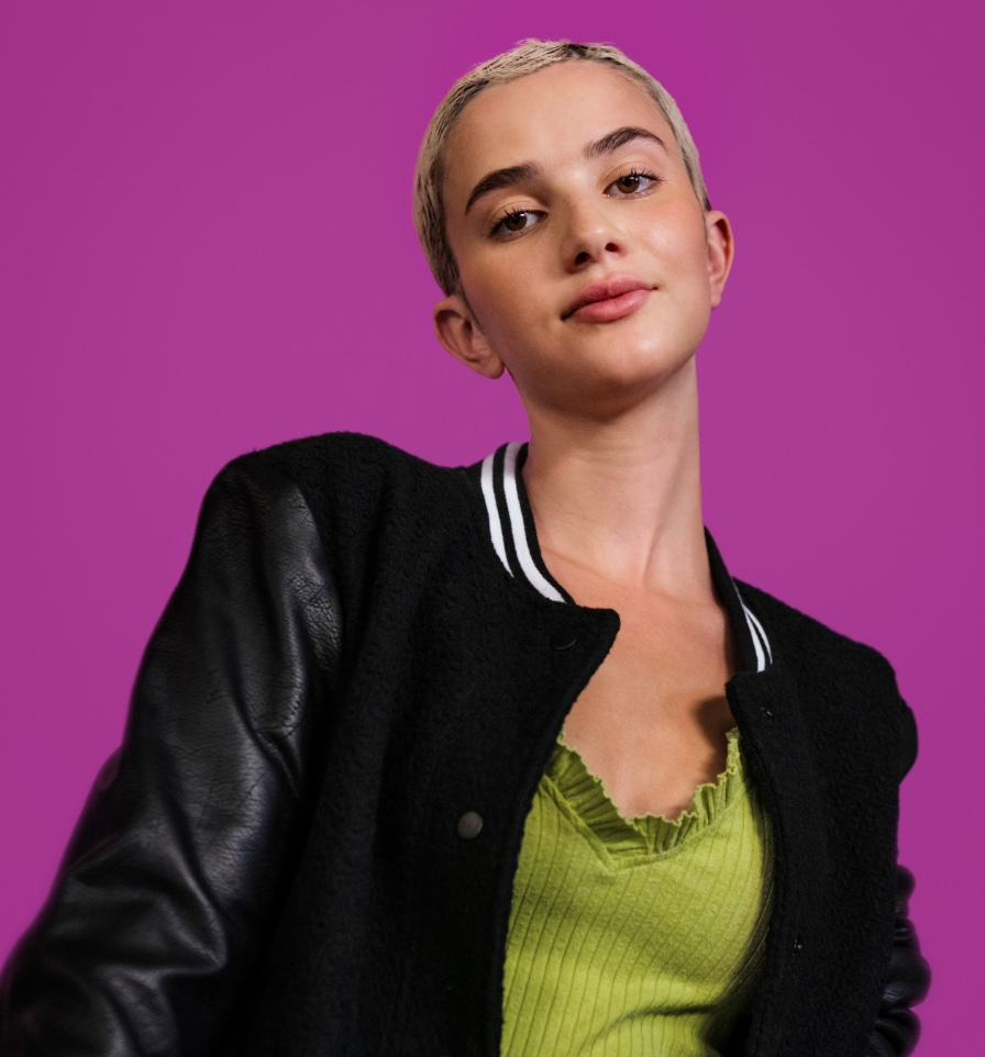 Professional Barber and Stylist Community Women with purple background and black jacket